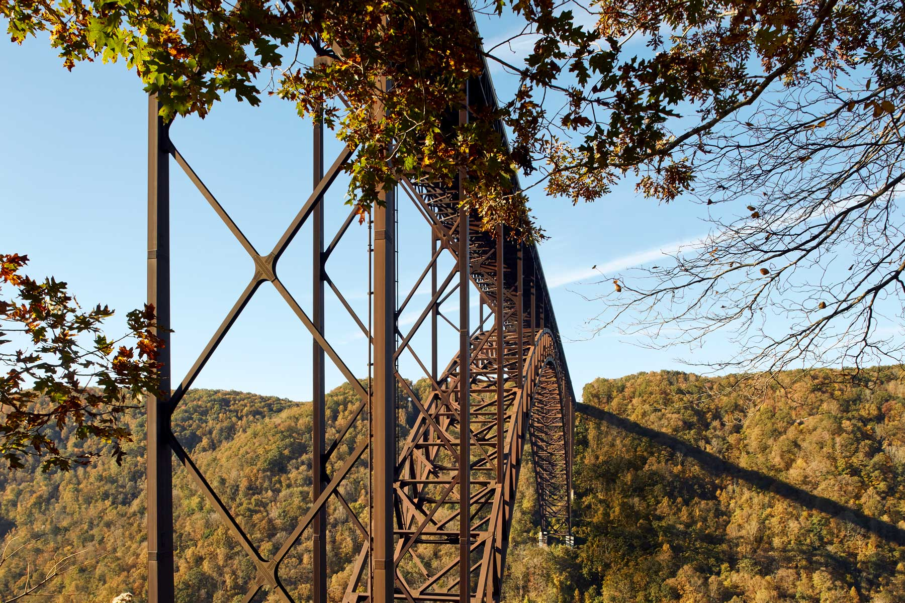 Low angle view of the New River Gorge Bridge in West Virginia, in autumn
